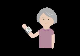 血圧測定する年配の女性